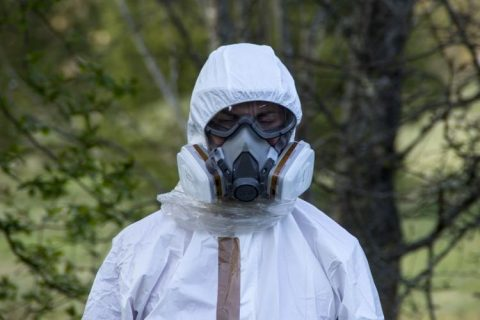 Image of person wearing protective gear for asbestos removal