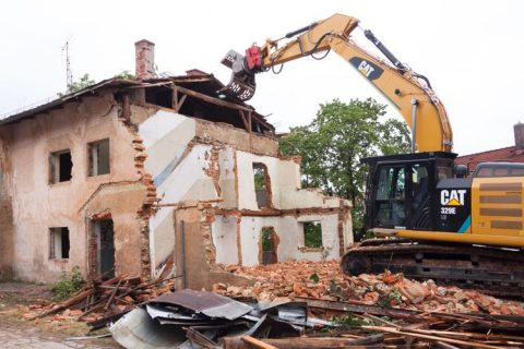 Image of house being demolished